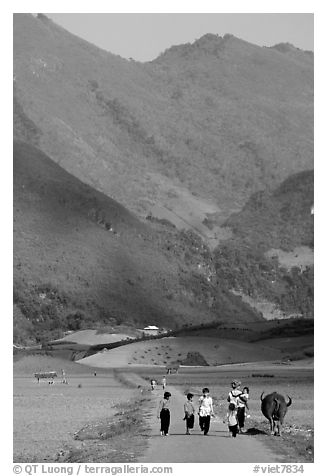 Villagers walking on the road, near Tuan Giao. Northwest Vietnam (black and white)