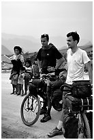 Western adventure travellers on mountain bikes, near Tam Duong. Northwest Vietnam (black and white)