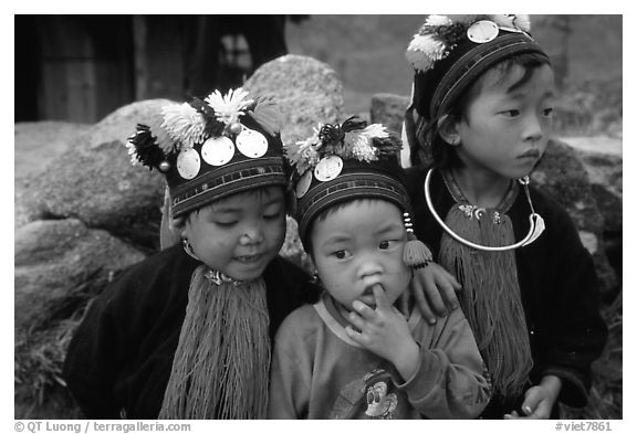 Black Dzao children wearing the hat with three coins, between Tam Duong and Sapa. Northwest Vietnam (black and white)