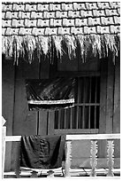 Detail of hut with montagnard dress being dried, between Tuan Giao and Lai Chau. Northwest Vietnam (black and white)