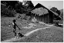 Unclothed child in a minority village, between Lai Chau and Tam Duong. Northwest Vietnam (black and white)