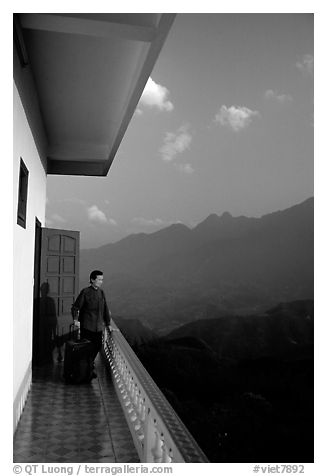 Traveler on a hotel balcony, looking at the Hoang Lien Mountains. Sapa, Vietnam (black and white)