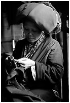 Red Dzao women sewing. Vietnam (black and white)