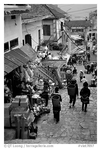 Black Hmong people in the steep streets of Sapa. Sapa, Vietnam (black and white)