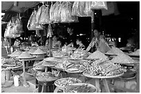 A variety of dried shrimp and fish for sale. Ha Tien, Vietnam (black and white)