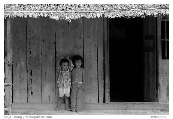Two kids in front of a hut. Hong Chong Peninsula, Vietnam (black and white)