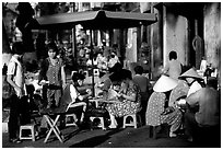 Eating in a street restaurant. Ho Chi Minh City, Vietnam ( black and white)
