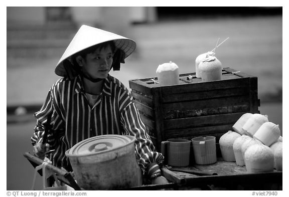 Coconut street vendor. The sweet juice is drank directly from a straw.. Ho Chi Minh City, Vietnam