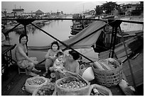Family selling fruit on a bridge. Cholon, Ho Chi Minh City, Vietnam ( black and white)