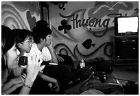 Karaoke session. Ho Chi Minh City, Vietnam (black and white)