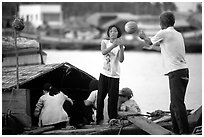 Unloading watermelons from a boat. Ha Tien, Vietnam (black and white)