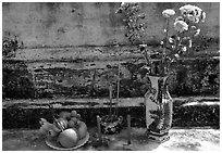 Flowers, fruit, and incense offered on a grave, Ben Tre. Mekong Delta, Vietnam (black and white)