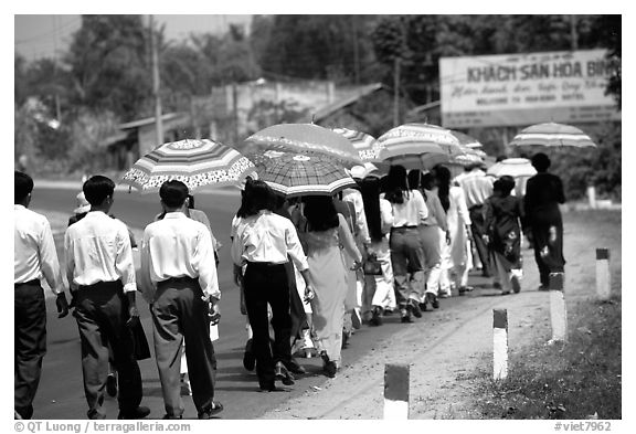Countryside wedding procession. Ben Tre, Vietnam (black and white)