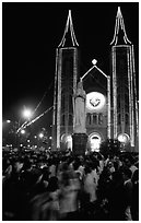 Crowds gather at the Cathedral St Joseph for Christmans. Ho Chi Minh City, Vietnam (black and white)