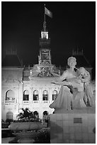 City townhall and Ho Chi Minh sculpture. Ho Chi Minh City, Vietnam (black and white)