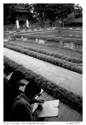 Art students drawing in the Temple of the Litterature. Hanoi, Vietnam (black and white)