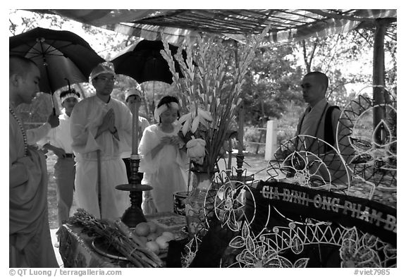 Mourning at a countryside funeral. Ben Tre, Vietnam (black and white)