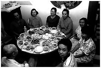 Family meal. Ho Chi Minh City, Vietnam ( black and white)