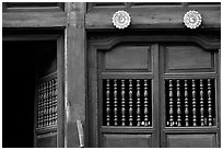 Detail of a wooden facade, Hoi An. Hoi An, Vietnam (black and white)