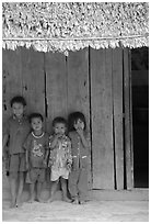 Children in front of rural hut, Hon Chong. Vietnam (black and white)