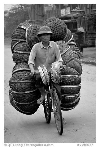 How large a load can you have on  a bicycle ?  On the way to the Perfume Pagoda. Vietnam (black and white)