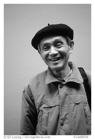 Man wearing the French beret, Hanoi. Vietnam (black and white)