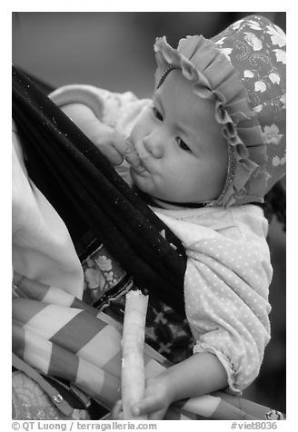 Baby enjoying sugar cane, the natural lollypop,  Bac Ha. Vietnam (black and white)