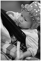 Baby enjoying sugar cane, the natural lollypop,  Bac Ha. Vietnam ( black and white)