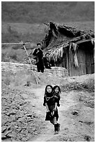 Black Hmong girl and family. Sapa, Vietnam (black and white)