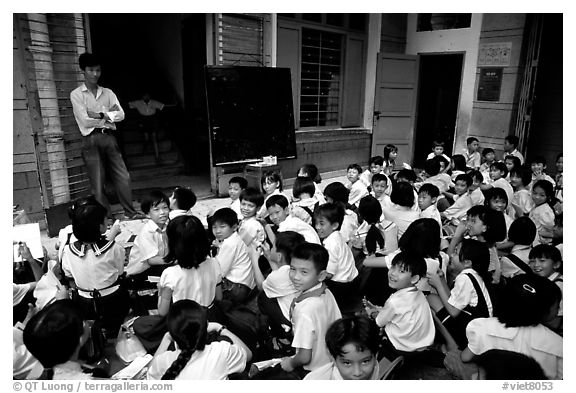 Children at school. Like everywhere else in Asia, uniforms are the norm. Ho Chi Minh City, Vietnam (black and white)