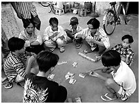 Children playing cards. Ho Chi Minh City, Vietnam (black and white)