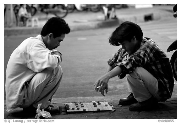 Chinese Chess game. Vietnamese people can sit on their heels for hours. Ho Chi Minh City, Vietnam