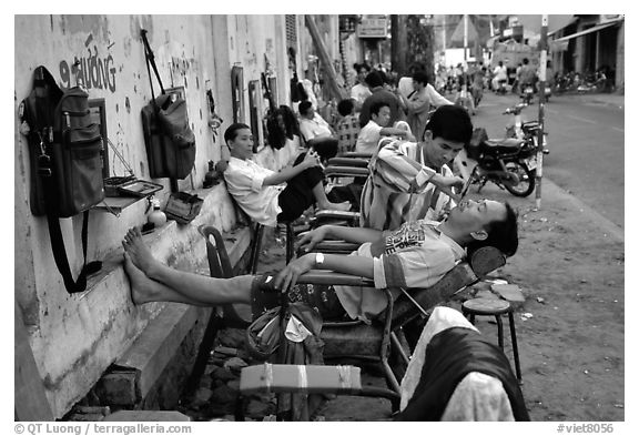 Outdoor hair dressing salon. Ho Chi Minh City, Vietnam (black and white)