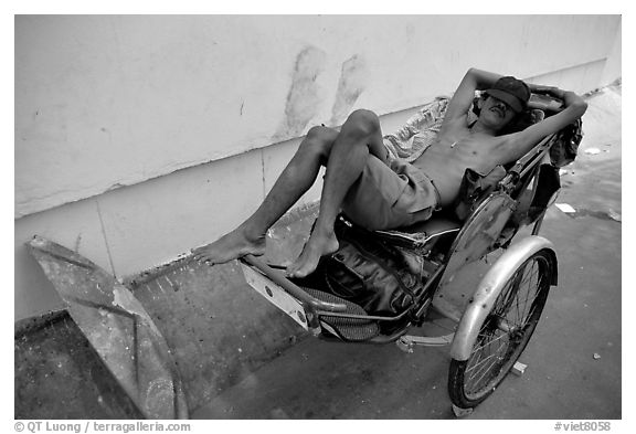 Cyclo driver taking an afternoon nap. Ho Chi Minh City, Vietnam (black and white)