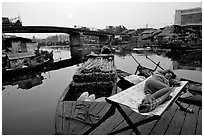 Sleeping out for the fresh air. Morning near the Saigon arroyo. Cholon, Ho Chi Minh City, Vietnam (black and white)