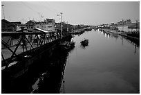Evening on the Saigon arroyo. Cholon, Ho Chi Minh City, Vietnam ( black and white)