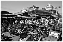 Cyclos wait outside the Bin Tay market in Cholon, District 6. Cholon, Ho Chi Minh City, Vietnam ( black and white)