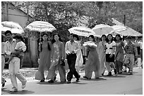 Traditional wedding procession on a countryside road. Ben Tre, Vietnam (black and white)