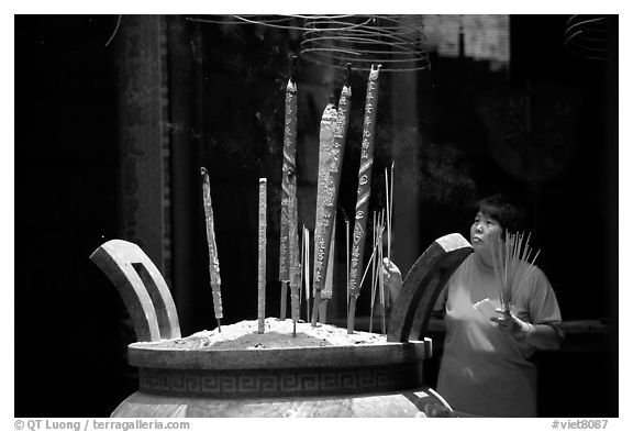 Offering incense at a Chinese temple in Cho Lon. Cholon, District 5, Ho Chi Minh City, Vietnam (black and white)