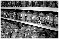 Cremation is popular. Ashes are collected in individual funeral urns. Ho Chi Minh City, Vietnam (black and white)