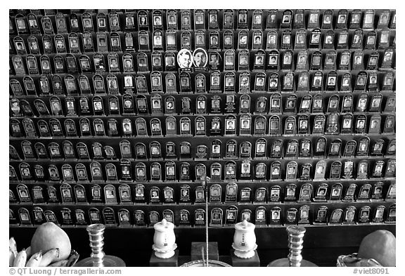 Pictures of the deceased for veneration on altar. Ho Chi Minh City, Vietnam (black and white)