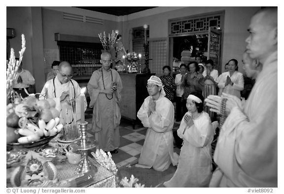 Buddhist funeral ceremony. White is color for mourning, Xa Loi pagoda, district 3. Ho Chi Minh City, Vietnam (black and white)