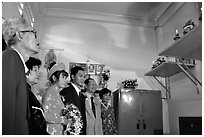 Bride presented to the groom's ancestors in the presence of both parents during a wedding. Ho Chi Minh City, Vietnam (black and white)