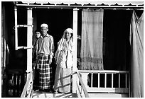 Muslem family outside stilt house in Cham minority village. Chau Doc, Vietnam (black and white)
