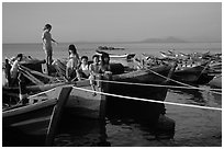 Children play on fishing boats. Vung Tau, Vietnam (black and white)