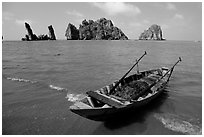 Boat and limestone towers, undeveloped beach. Hong Chong Peninsula, Vietnam (black and white)