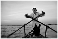 Woman using the X-shaped  paddle characteristic of the Delta. Can Tho, Vietnam ( black and white)