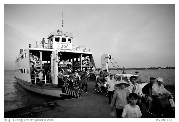 Disembarking from a ferry on one of the many arms of the Mekong. My Tho, Vietnam (black and white)