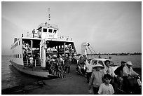 Disembarking from a ferry on one of the many arms of the Mekong, My Tho. Mekong Delta, Vietnam (black and white)