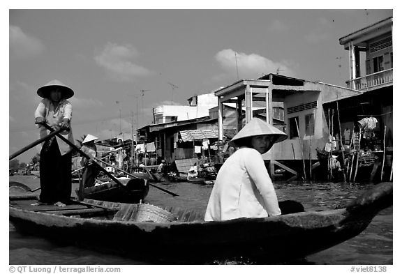 River at the back of townhouses, more used than the road at the front, Phung Hiep. Can Tho, Vietnam (black and white)